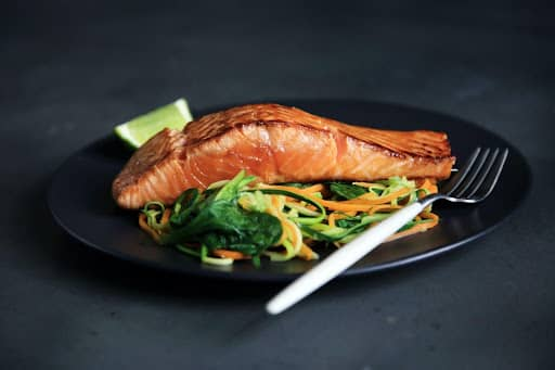 cooked salmon on vegetables